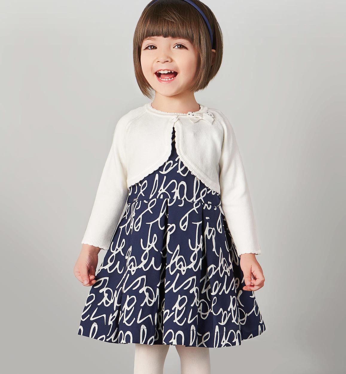 huge selection of fc206 c0e46 Prezioso abito smanicato con scritte e fili lurex per bambina da 6 mesi a 7  anni Sarabanda