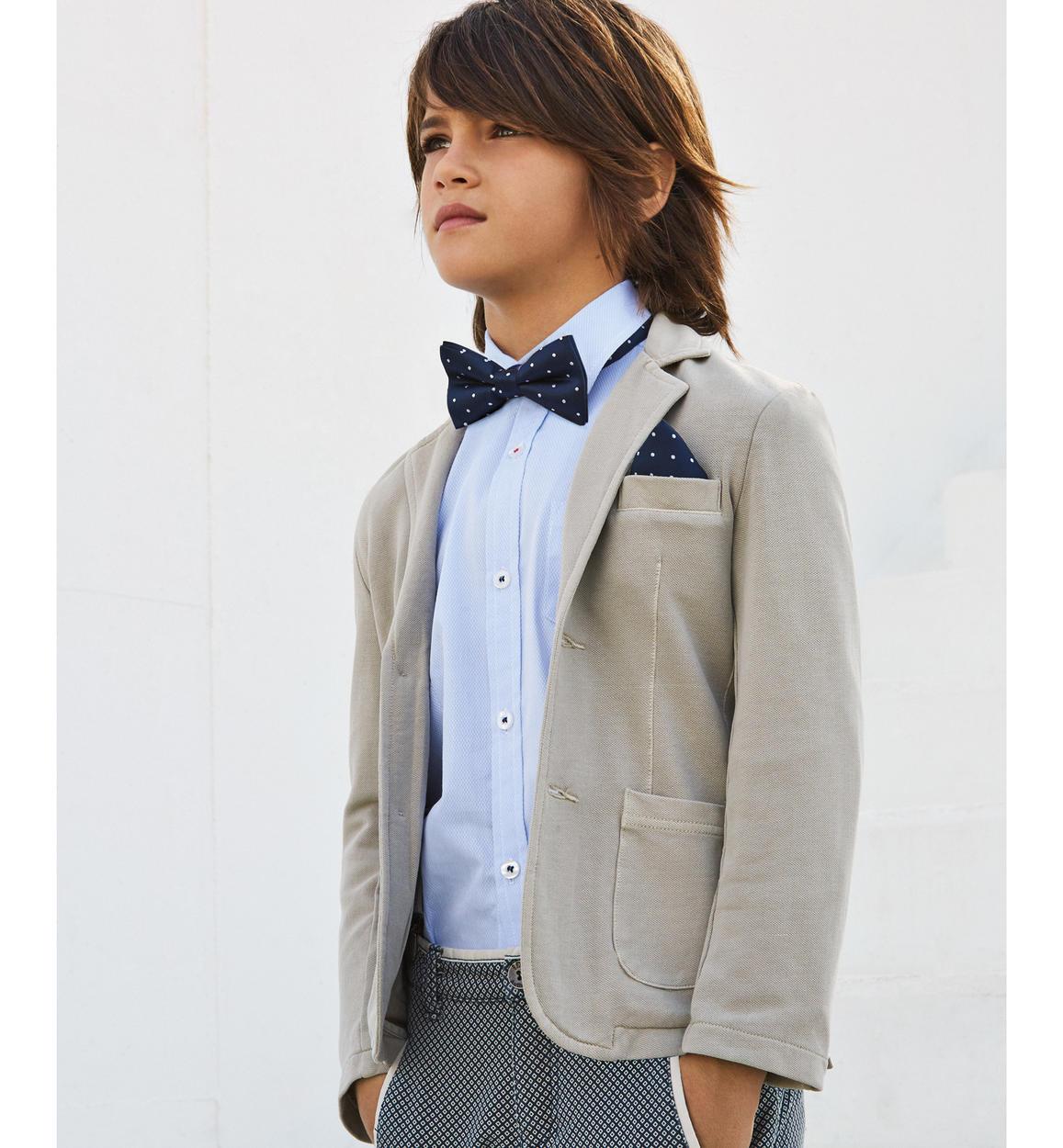 foto ufficiali 44a4d 78ab5 Elegante giacca modello avvitato in piquet stretch di cotone per bambino da  6 a 16 anni iDO